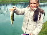 A daughter's first fish